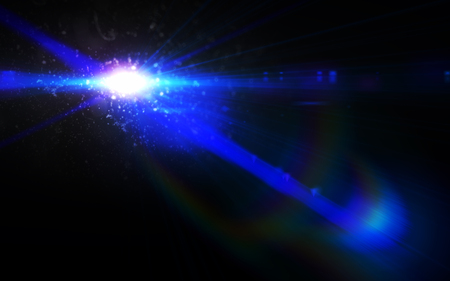 Abstract green lens flare light over black background