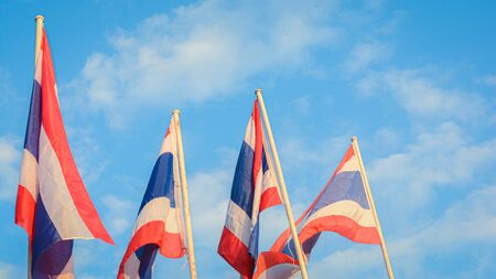 Thai flags wavy with sky background