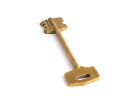 Gold key isolated on white background photo