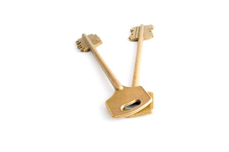 Gold key isolated on white background photo