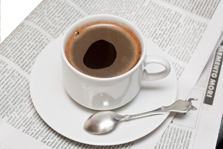 Cup of coffe on newspaper Stock Photo - 6510770