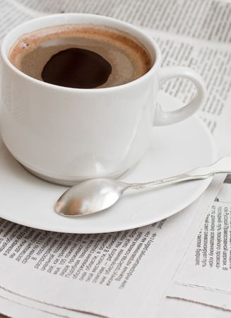 Cup of coffe on newspaper photo