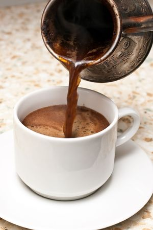 Pouring coffee in a cup Stock Photo - 6596497