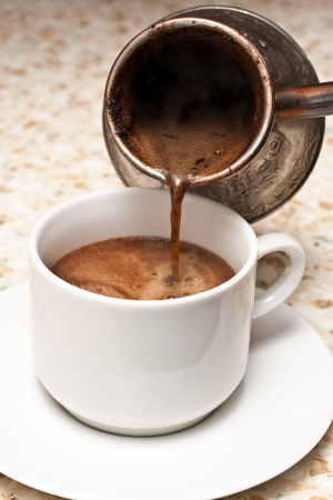turkish coffee: Pouring coffee in a cup Stock Photo