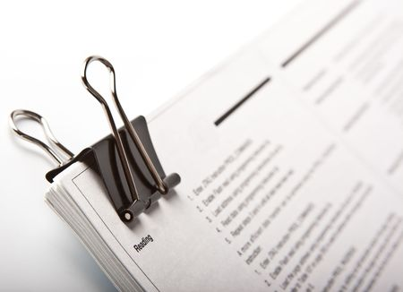 Binder clip and stack of paper  Stock Photo - 8158230