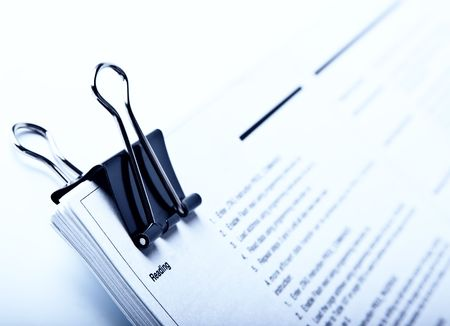 Binder clip and stack of document  in blue tone Stock Photo - 8158232