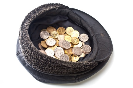 beggary: Coins in old cap