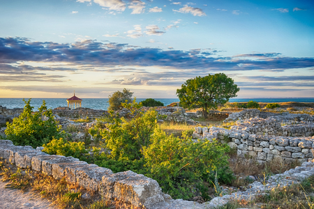 Marine landscape with views of the ruins of the ancient city of Hersonissos on the background Stock Photo