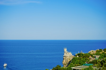 Yalta, Crimea-June 16, 2014: Seascape with a view of the famous swallows nest against the blue sea.