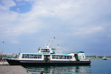 Sevastopol, Crimea-June 14, 2015: Passenger sea transport on the pier at the waterfront of the city.