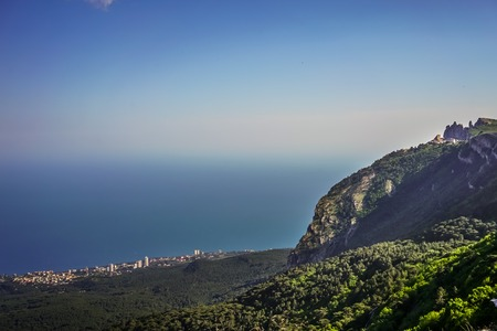 View from mount AI-Petri on the sea and the surrounding area of the city under the blue sky. Stock Photo