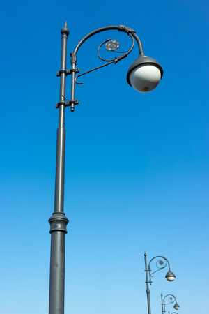 A decorated street lamp, blue sky in the background. for design and networking