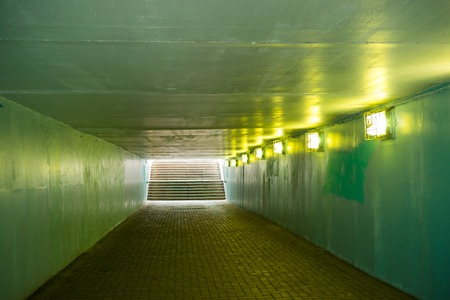 Vladivostok, Russia: Underground passage of green color without people with artificial lighting.