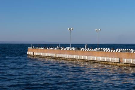 Vladivostok, Russia-December 1, 2018: Seascape with coastline and berth. 版權商用圖片