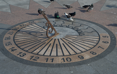 Sevastopol, Crimea-may 31, 2018: Sundial with pigeons on the waterfront of the city