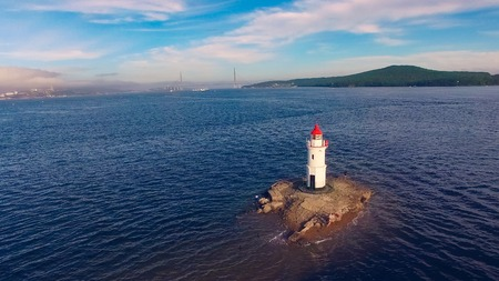 White lighthouse with red roof on Tokarev cat. Vladivostok, Russia