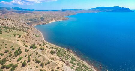 Aerial view of the mountain landscape by the sea. Sudak, Crimea