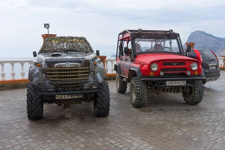 Sudak, Russia-may 20, 2018: Cars SUVs on the waterfront of the city.