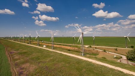 Evpatoria, Crimea-may 25, 2018: Panorama of wind farms against the blue sky with clouds.