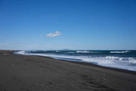 Seascape with Alatyrsky volcanic beach on the Kamchatka Peninsula. 写真素材 - 132313264