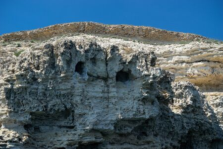 Natural scenery. View of the rocks against the blue sky. 写真素材 - 133344525