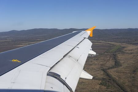 Airplane wing on the background of autumn landscape. 写真素材 - 133344527