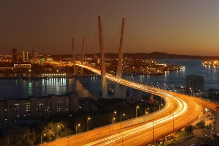 Sunset over Vladivostok and view of the Golden bridge, Russia.