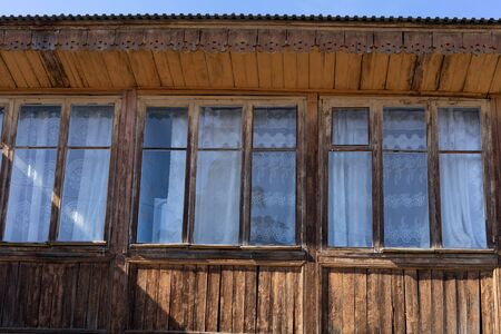 The facade of a wooden building with Windows. Gurzuf, Crimea 写真素材