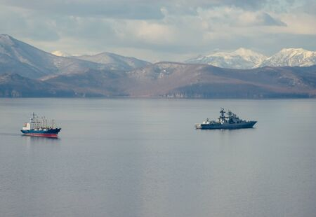Ships on the background of seascape and mountains. Avacha Bay, Kamchatka 写真素材 - 133344530