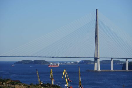 Vladivostok, Russia. Seascape with views of the Russian bridge and the coastline with cranes. 写真素材 - 132755954