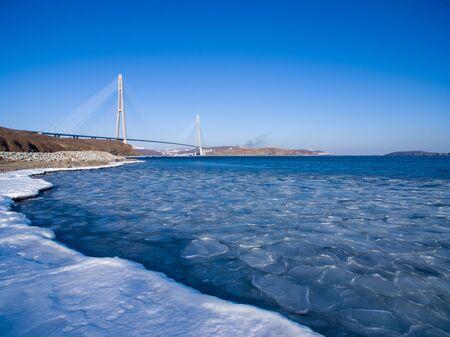 Vladivostok, Russia.Russian bridge against the blue sky. 写真素材 - 132757514