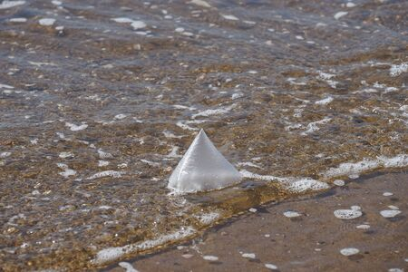 Natural background with a plastic bag on the background of water. 写真素材 - 132759632