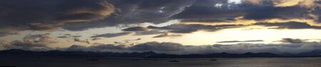 Panorama of the sea landscape under the evening sky, Kamchatka 写真素材 - 133345320