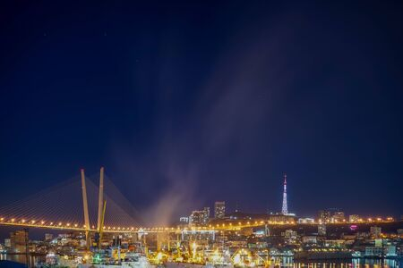 Night landscape of Vladivostok overlooking the Golden bridge
