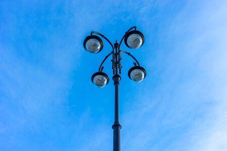 Beautiful street lamp on blue sky background. Vladivostok, Russia