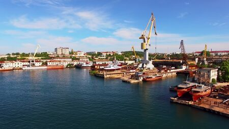 Aerial view of the coastline of Sevastopol with ships and cranes