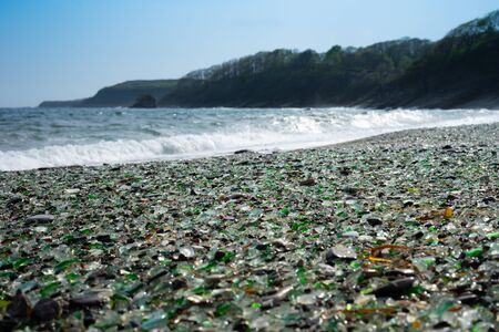 Seascape with a rock in the waves. Glass beach in Vladivostok. 写真素材