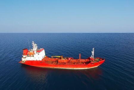 Red ship on the background of seascape and blue sky 写真素材