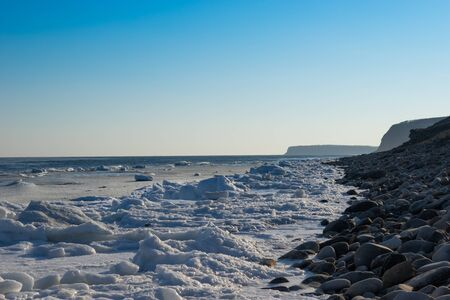 Marine landscape with views of the icy shore in winter