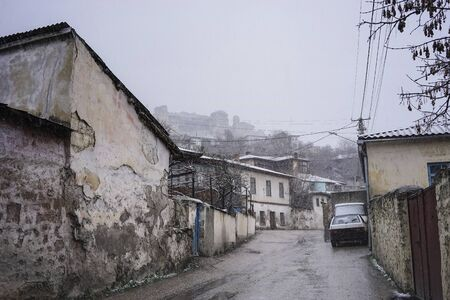 Cityscape overlooking the old streets of Bakhchisaray in winter, Crimea.