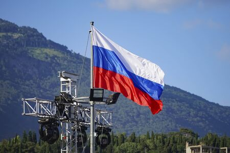 Russian flag on the background of mountains in Yalta, Crimea 写真素材