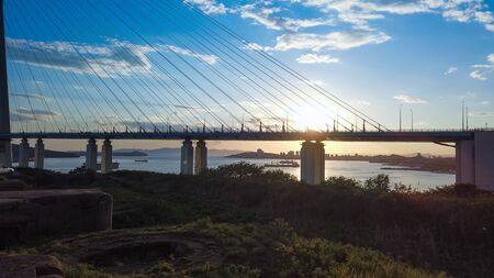 Natural landscape with views of the Russian bridge and sunset. Vladivostok, Russia.
