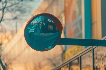 Urban landscape with a road mirror and the reflection of cars and people 写真素材