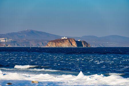 Island on the background of the seascape. Vladivostok, Russia.