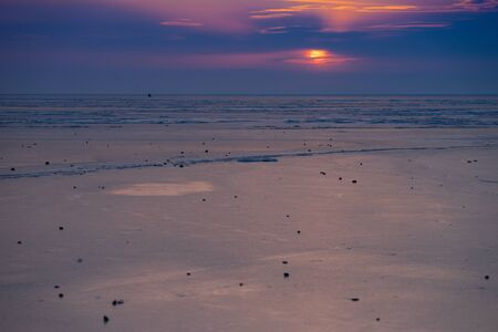 Sunset over the frozen surface of the Amur Bay. Vladivostok, Russia 写真素材
