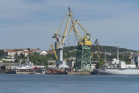 Industrial landscape with cranes in the seaport of Sevastopol.