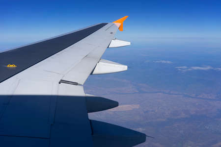 Aircraft wing on the background of the landscape. Travel and tourism