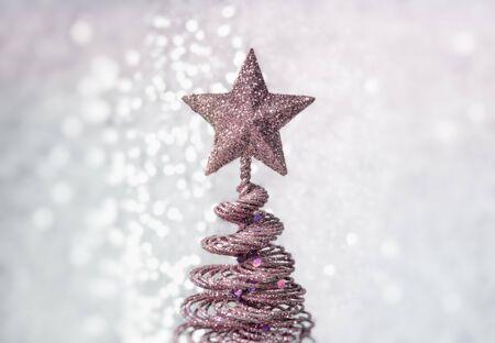 Christmas background with shiny Christmas tree on light background