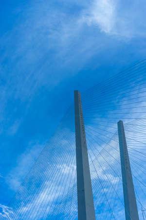 Construction of the Golden bridge against the blue sky. Vladivostok, Russia