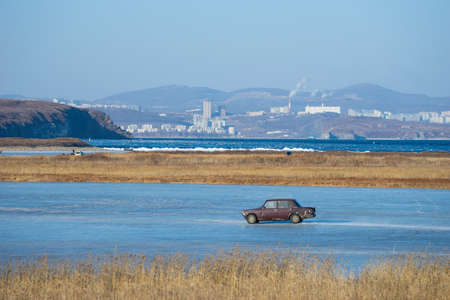 Natural landscape overlooking an old car on a frozen lake. Vladivostok, Russia. 写真素材